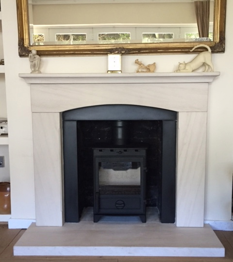 Fireplace installation, limestone fireplace, multifuel stove, stove, woodburner