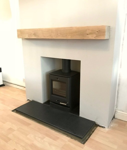 oak beam fireplace, multifuel stove installation, granite hearth