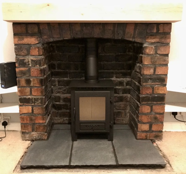 Wood burning stove installation Bristol, stone hearth, brick fireplace