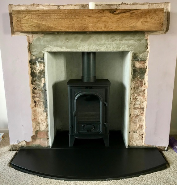 curved hearth, slate, fireplace installation, log burner installation