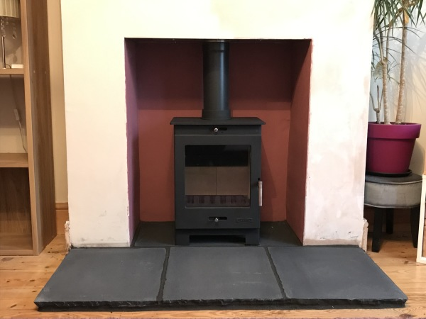 Multifuel stove, stone slab fireplace hearth