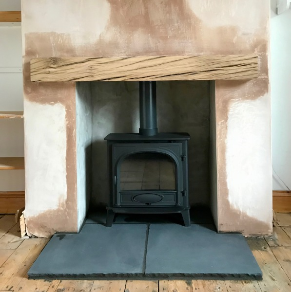 Solid oak beam mantle, wood stove installation, fireplace installation